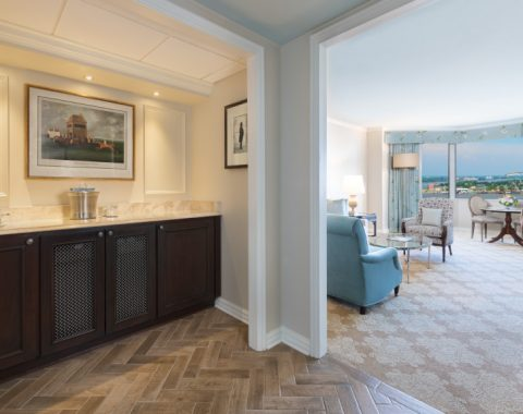 view of wet bar and living area in a Windsor Court suite