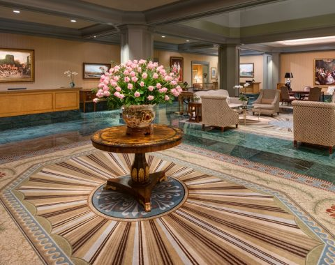 lobby of Windsor Court hotel featuring pink rose display