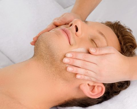 Spa services being performed a man's face